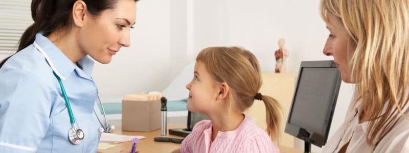 family practice nurse working with child