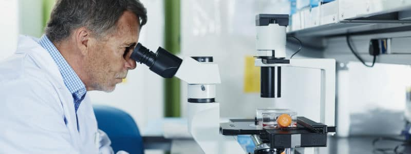 clinical lab scientist with microscope